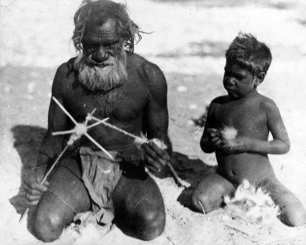 Australian indigenous elder and child